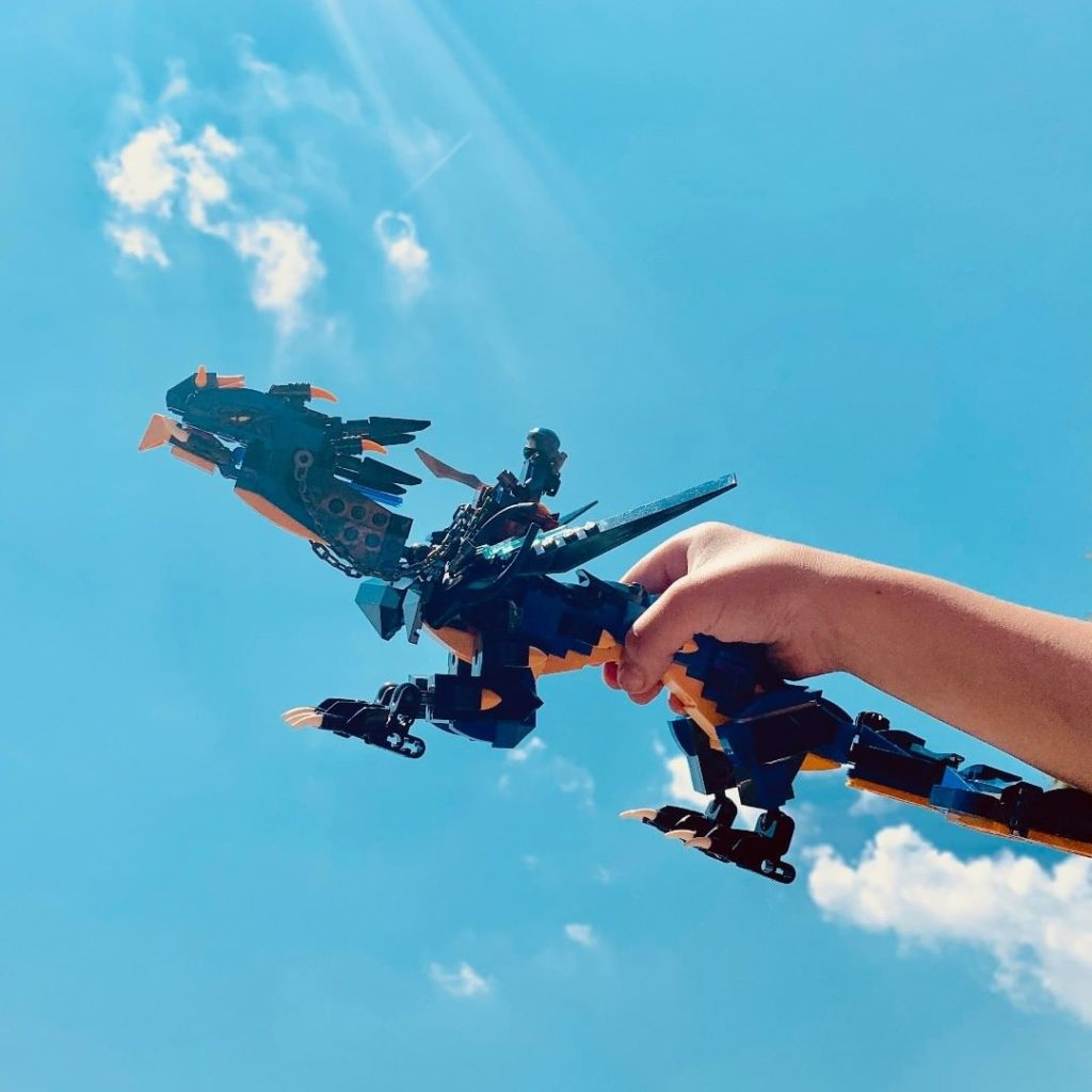 Lego Ninjago stormbringer dragon - flying with blue sky and clouds