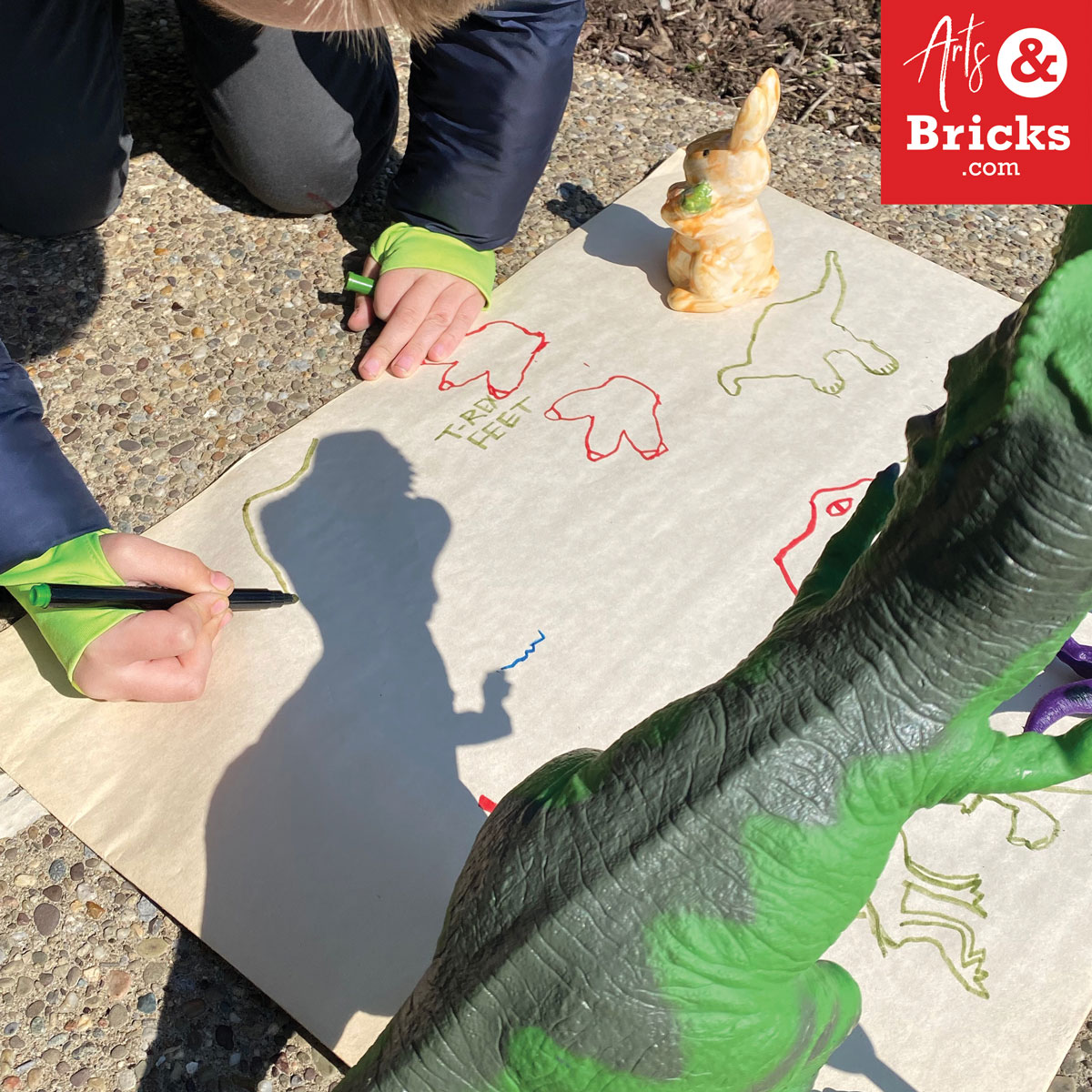 Explore the shadows that your toys make in the afternoon sun; simple art project outdoors.