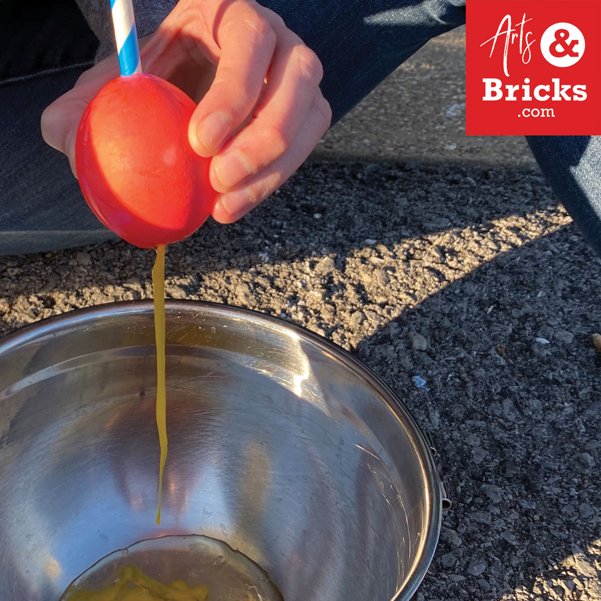 Use a straw to blow out your egg.