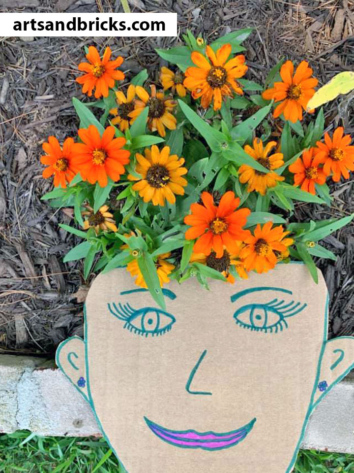 flower-hair-cardboard-face-kid-art