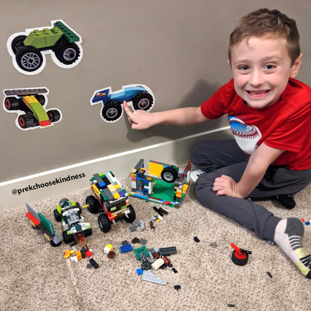 Young boy enjoying his LEGO-Brick Built Race Car wall decals by Arts and Bricks.